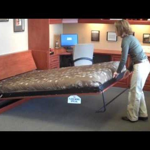 Woman Demos A Murphy Bed