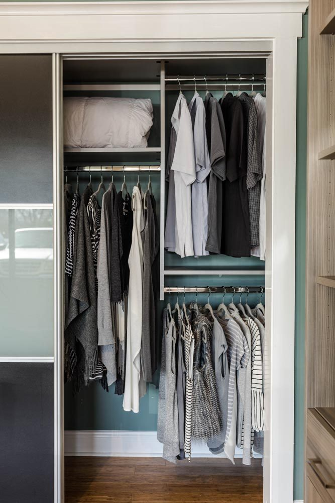 clothes hanging in a walk in closet