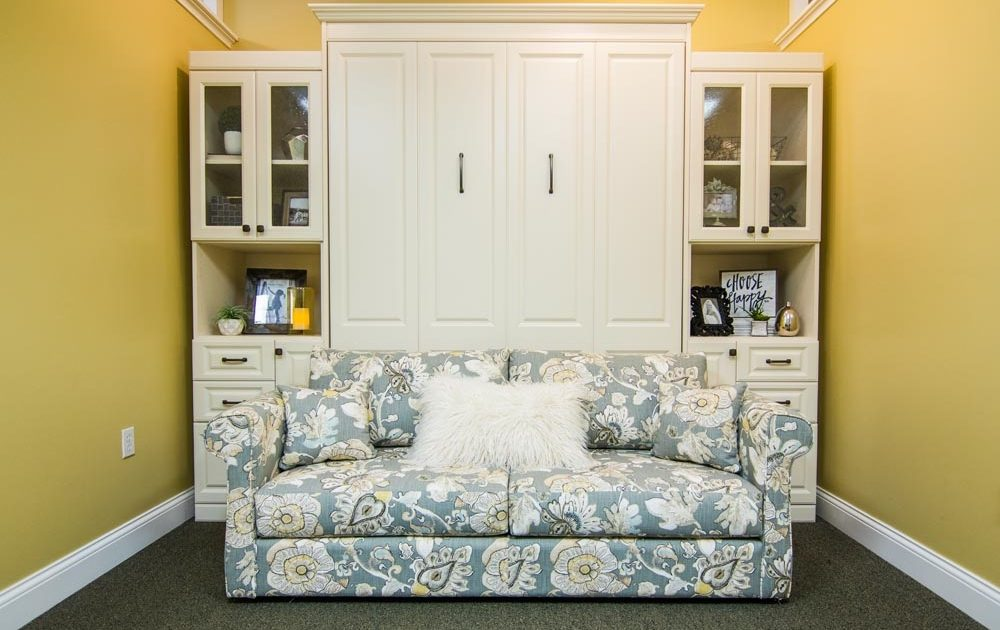 floral sofa in front of murphy bed