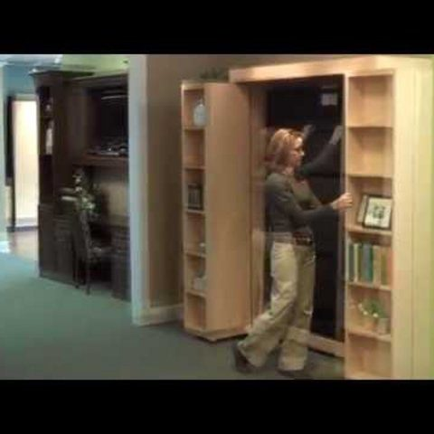 Woman Demos Shelving For Murphy Bed